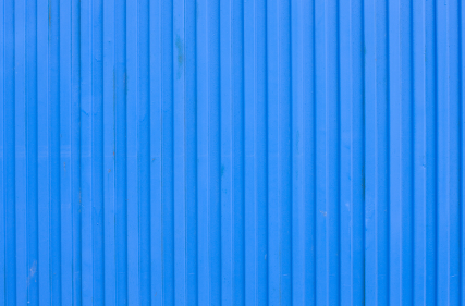 A corrugated metal siding that is typically used for an industrial building.